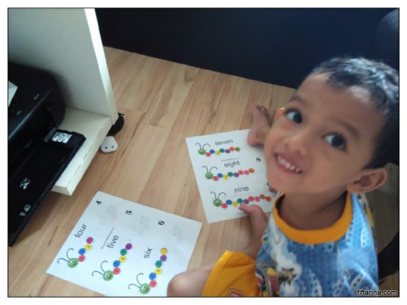 Happy face doing counting caterpillar busy bag