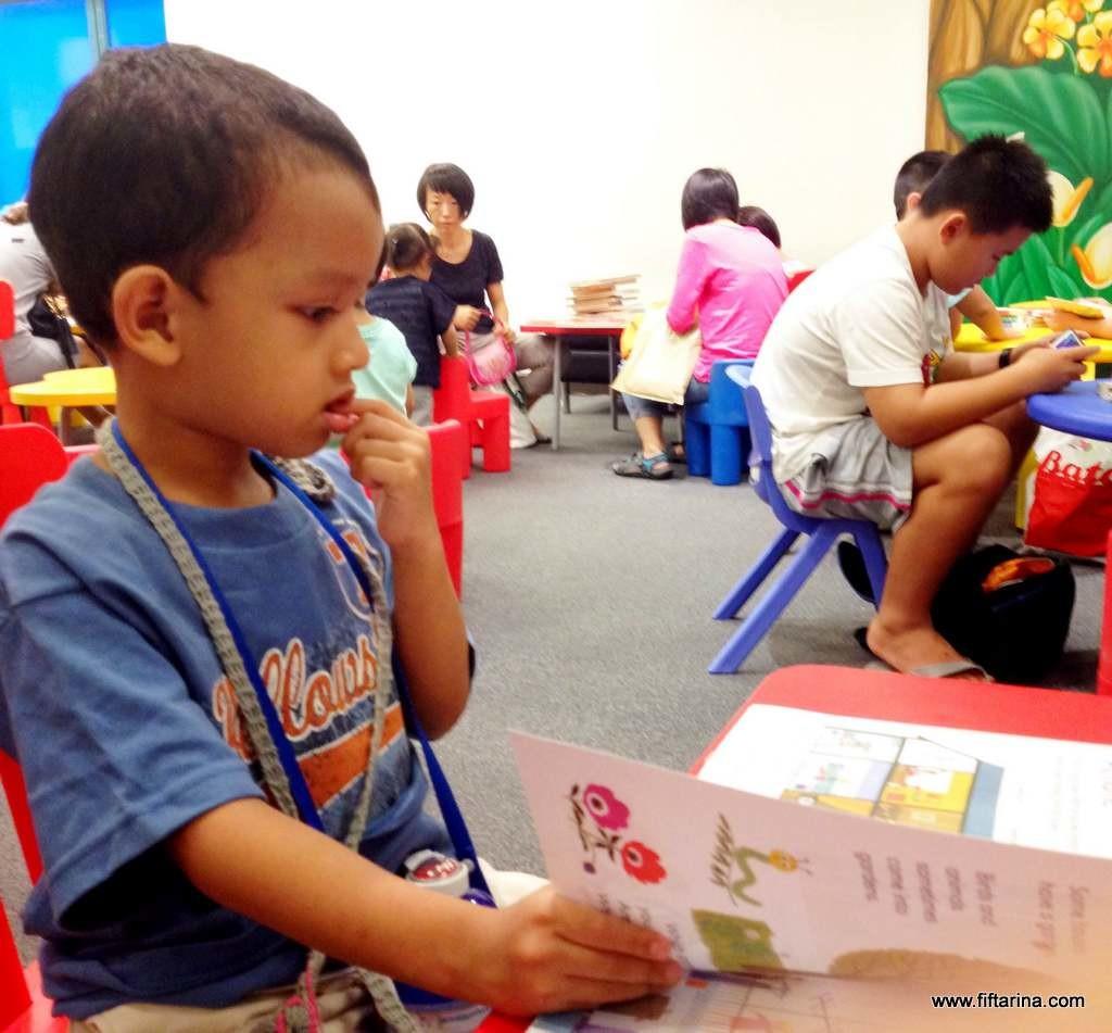 Abdurrahman reading a book in library, so focused!