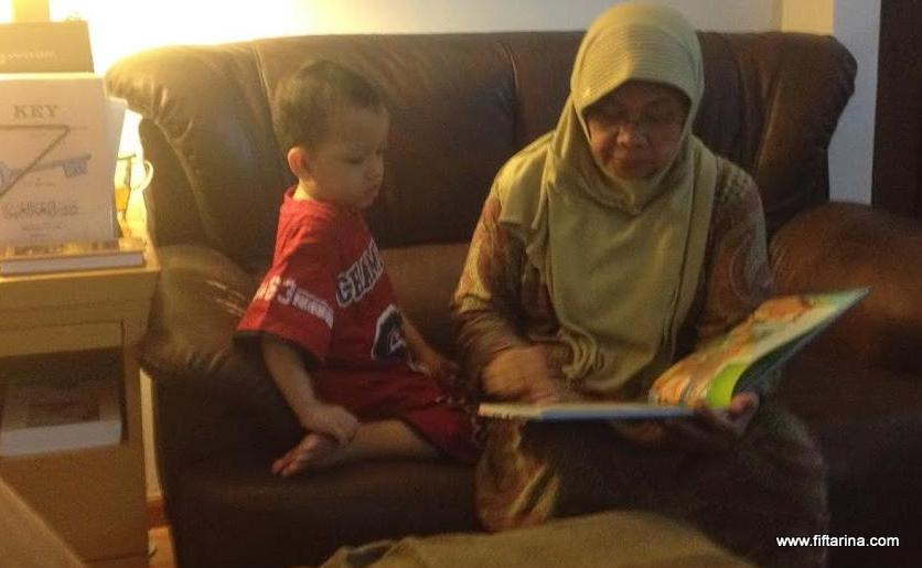 Abdurrahman reading with grandma