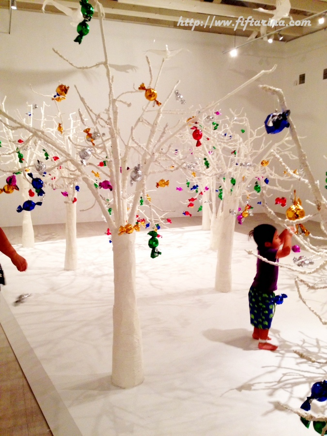 Hanging colorful sweets on white trees